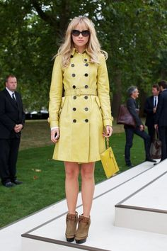 fashion goer looking chic in a burberry trench coat at london fashion week