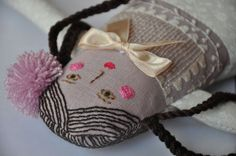 Handmade fabric doll with embroidered face and body by ESZTERDA