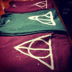 DIY harry potter T-shirts. really easy to do: use bleach and a brush!