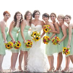 The bridesmaids wore mint-colored dresses to complement the color scheme without being overwhelming. They also wore nude shoes and simple jewelry so their bouquets would stand out. - Jennifer Mott Photography