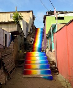 "Peruvian street artist Xomatoc who is known for his creative use of color, collaborated with creative educators Crehana to create for the Santa Rosa housing association in the Villa El Salvador district of Lima, Peru, the ""Serpiente de luz"" (Snake of Light), a long concrete stairway brightly painted in spectral colors that glow underneath the South American sun."