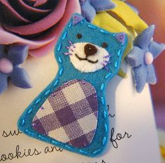 cute kitty- maybe for hair clips?