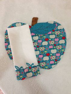 "I don't know it this is a placemat and napkin of a potholder and a tea towel, but I love the ""napkin"" trim, and want to make some sets like this as placemat and napkins."
