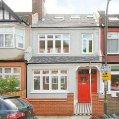 LOVE: grey painted brick + same colour on pebbledash. PLUS original style tiling on path. not sure about red door - navy blue/dark grey would work?