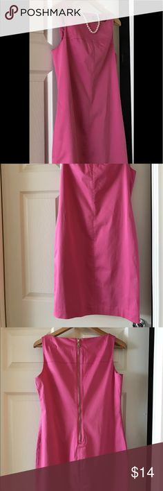 Pink Ralph Lauren dress Classy & ladylike. Lovely pink Ralph Lauren dress. Very Jackie O with pearls or Carrie Bradshaw with an edgy belt. Excellent condition. It is machine washable on delicate & low heat in the dryer. It will need to be ironed after the dryer. Dresses Midi