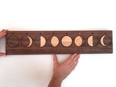For the moon lovers out there, here's a beautiful moon phases wall hanging featuring a peg that can be moved along the top row to signify each phase of the moon. A great teaching item that the kids will enjoy. Space Activities, Cnc Projects, Moon Lovers, Beautiful Moon, Linseed Oil, Christmas Delivery, Space Crafts, Wood Toys, Moon Phases