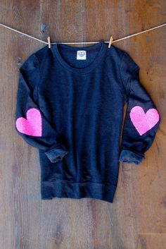 This darling sweatshirt is sure to dazzle your friends.    Images - Charcoal Grey w/Neon Pink Heart Elbow Patch    Handmade elbow patches made with