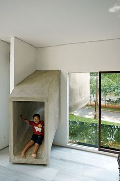 Slide!   I would love to call the kids down for dinner and have them be able to slide down to the kitchen... How cool!!