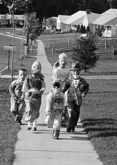 Trick or treating in 1966. Sad that kids today miss out on the fun we had going door to door.,. I have finally given up on waiting for kids to come to my door for treats.... It was one of my favorite holidays; right up there with Christmas.
