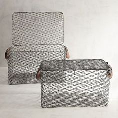 With a small nod to the lobster traps of Maine, our Kasey basket collection is handcrafted with an antiqued finish. Faux leather handles add to the classic look, for storage that has a slightly rustic-meets-industrial style.