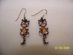 Baby tiger wiggley earrings by EagleplumeCreations on Etsy, $14.99