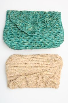 """African Crocheted Clutch - Crocheted clutch purse, raffia shell design with a metallic thread detail throughout, lined, magnetic closure, small inside pocket, Aprox 10 1/2"""" across by 7"""" down. Available in natural and aqua. Easily holds all the essentials."""