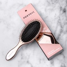 A rose gold detangling brush that'll smooth out your unruly hair with minimal pain and breakage. Bonus: it's so attractive, you can just leave it on the counter. Best Gifts Under 50, Detangling Hair Brush, Paddle Brush, Hair Supplies, Wand Curls, Wet Hair, Professional Hairstyles, Hair Tools, Hair Hacks