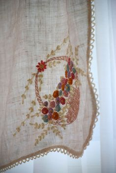 French knot work at its best. Plus the color palette is gorgeous.