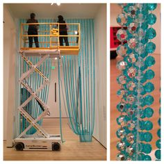 "New beads!  The beaded curtains designed by Felix Gonzalez-Torres are meant to be touched and walked through. This morning we hung ""water"" colored beads in place of the ""golden"" beads previously hanging in the Linde Family Wing for Contemporary Art. The artist designed versions in five different colors—this is the third color we have installed since the wing opened."