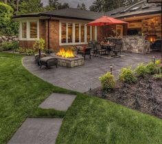 Backyard courtyard with Firepit - Outdoor Living Room w/Fireplace - stamped concrete patio - looks like large pavers - #BackyardsIdeas #outdoorpatioideas