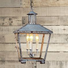 """Hang this galvanized metal lantern inside for a rustic look. Perfect for a shabby chic cottage to a rustic lodge. 3x40 watts. (candle base socket)(19""""Hx12""""W)3' chain5"""" round canopy"""