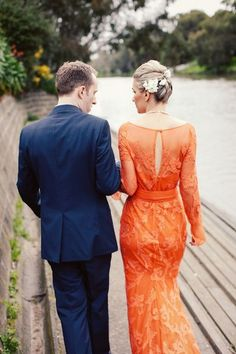 Orange is an energizing fall wedding color, and this wedding dress proves just that. Photo: Louisa Baileyv via Polka Dot Bride; Bride's Dress: Carla Zampatti