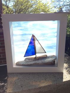 Drift Away Art is a mixture of Canadian driftwood and stained glass captured in the form of mini sail boats, Beach Huts, framed Art and crazy eyed fish set upon a unique piece of glass infused driftwood.