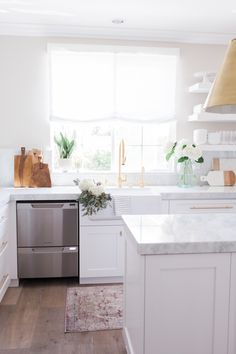 Chic White Kitchen with gold hardware 11