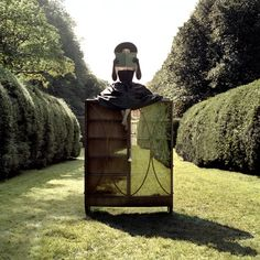 ZOE READING ON CABINET IN HEDGES, LONG ISLAND, NEW YORK, 2004-Rodney Smith