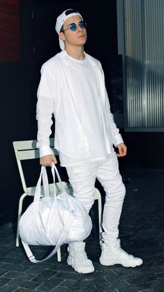 he knows he's killin' it, all white everything...  looking like the dope boy