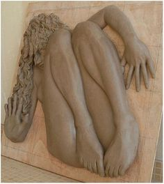 The bas relief sculpture is first molded from clay to determine depth and scale