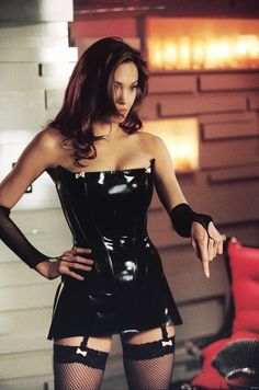 For the 2005 sexy spy film, 'Mr Mrs. Smith', Syren was commissioned to create a custom latex outfit for the always stunning Angelina Jolie for her memorable dominatrix scene. Mr And Mrs Smith, Sexy Latex, Jolie Lingerie, Latex Dress, Latex Outfit, Latex Corset, Fashion Moda, Sport Fashion, Celebs