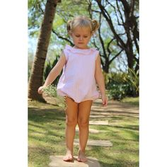 This beautiful loose-fit girl romper made in pink striped cotton seersucker features a delicate ruffled collar, back buttons, elastic leg and buttons at inseam for easy diaper change. Key features: seersucker cotton Elastic leg holes Back Buttons Girls Rompers, Pink Stripes, Seersucker, Collars, Legs, Summer Dresses, Cotton, Baby, Fashion