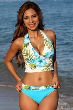 The beautiful hues of a tropical beach, the Maui banded two piece swimsuit is fresh and breezy with designer details. The longer style of the bathing suit top offers modest coverage and the banded bottom can be adjusted to suit you perfectly.