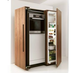 The fridge hides out behind the wood exterior when not opened. #kitchendesign