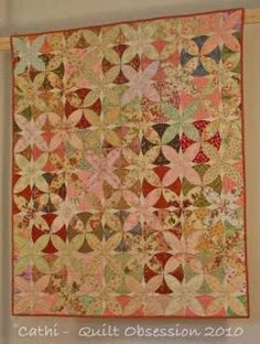 Cathi made this quilt using the Alabama Beauty block in the Orange Peel Deluxe Collection.