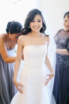 Bride -- Wedding Gown by Junko Yoshioka || See the wedding on Style Me Pretty: http://www.StyleMePretty.com/little-black-book-blog/2014/02/20/gray-pink-white-trump-national-golf-club-wedding/ Photography: AhmetZe