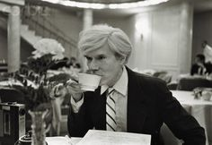 Andy Warhol drinking coffee