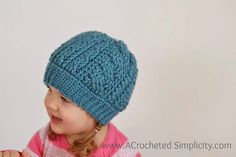 Enjoy this free crochet pattern and learn how to crochet a Cabled Beanie The pattern includes sizes toddler thru adult. Video Tutorial Included!