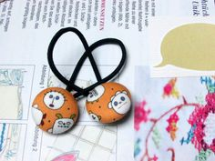 Check out this item in my Etsy shop https://www.etsy.com/listing/245561825/button-ponytail-holders-halloween