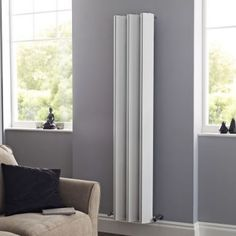 Add contemporary style to any room of your home with the Hudson Reed Templar vertical designer radiator