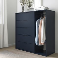 NORDMELA Chest of drawers with clothes rail, black-blue, cm. This clever piece with roomy drawers and a clothes rail accommodates both folded and hanging clothes. It takes up little space and is easy to place, whether in your bedroom or in the hallway. Clothes Rail Ikea, Clothes Drawer, Hanging Clothes, Dresser Storage, Dresser Drawers, Locker Storage, Black Chest Of Drawers, Bedroom Chest Of Drawers, Ikea Hemnes Chest Of Drawers