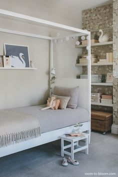 A soft grey-based style with pink and vintage accents.