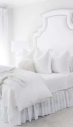 i LOVE all white bedding, it looks more comfortable for some reason