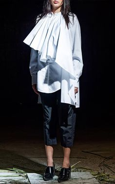 This **Nabil Nayal** Fortune blouse features an asymmetric draped ruffle panel, cape-like back, and a mandarin collar.