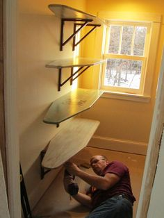 Old Ironing Boards = Shelving for the Laundry Room. Cute idea!