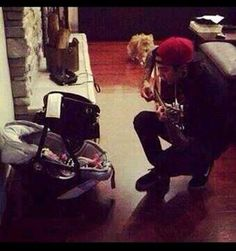 HE'S PLAYING THE GUITAR TO A TINY INFANT. I'M IN TEARS