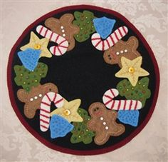 """Vintage Christmas Cookies Candle Mat Pattern.  Finished Size 16"""" round  Betsy Lou Pattern Company was initiated by Betsy Moyer and Louann Edmiston in Findlay, Ohio. Both women were taught to sew at an early age by their mother and grandmother respectively and have been sewing ever since. The launch of their pattern company grew from their desire to share their sewing experiences with others."""