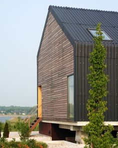 Cladding wrapping the eves, clean lines