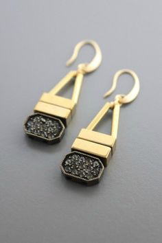 These fabulous earrings add the perfect sparkle to your outfit. The beautiful 18K gold plated brass with hematite beads and glass rhinestones is subtle yet very intricate and beautiful.  Plated Brass Earring by David Aubrey. Accessories - Jewelry - Earrings Idaho