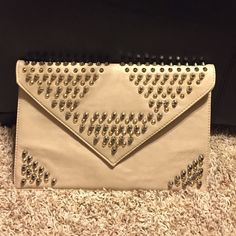 Blush/nude pink studded envelope clutch Blush/nude pink envelope clutch adorned with silver and gold studs. 13.5 inches in length and 9 inches in height. Never used! Great condition! Feel free to make an offer! Bags Clutches & Wristlets