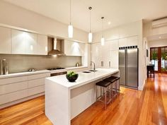 warm wood floor kitchen design idea
