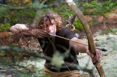 Hunting with bow and arrows.