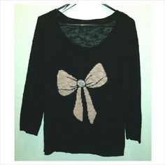 Black Bow Sweater XL New without Tags - Never Worn  I had purchased this to wear on Christmas, took the tags off, put it on & decided I didn't like how it fit. Never got around to returning it.   Size XL (juniors) = women's med/lg  Black scoop neck, 3/4 sleeve sweater. Baby pink bow across the front with sparkly gems in the center. t/o Sweaters Crew & Scoop Necks